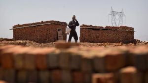 Fetching drinking water at a brick kiln in Ghasera, on the outskirts of New Delhi, India, on May 27, 2015. (AP / Saurabh Das)