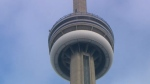 A 26-year-old American man is facing three charges for allegedly bringing a loaded handgun into the CN Tower on Friday. (file photo)