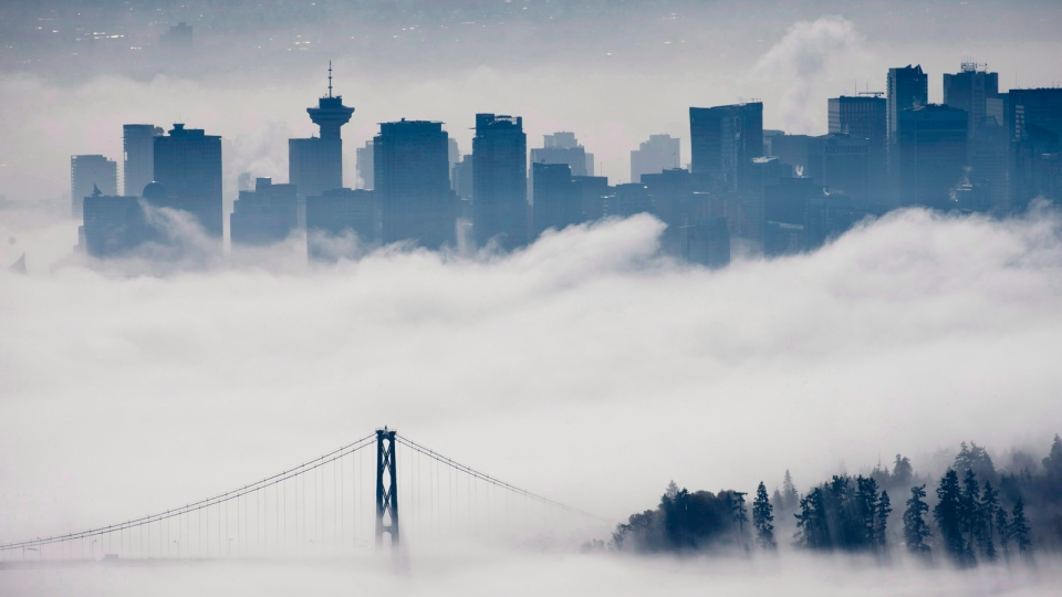 The fog-covered city is seen from Cypress Mountain in West Vancouver, B.C., on Oct. 23, 2013. (Jonathan Hayward / THE CANADIAN PRESS)