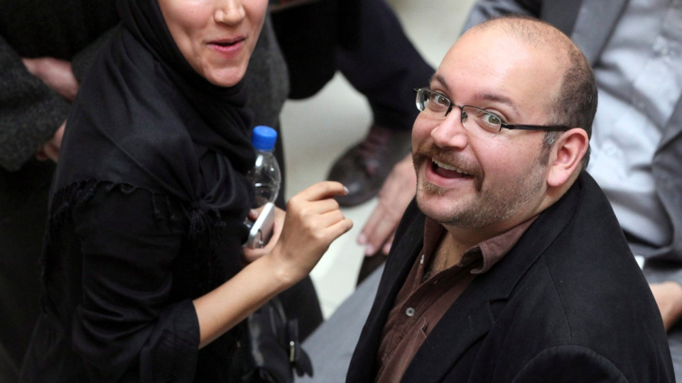 Jason Rezaian, right, an Iranian-American correspondent for the Washington Post, and his wife Yeganeh Salehi in this photo from Apr. 11, 2013. Rezaian is now on trial for espionage. (AP / Vahid Salemi)