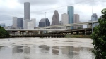 Flood waters overrun the banks of the bayou in downtown Houston, on May 26, 2015. (AP / Pat Sullivan)