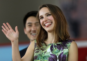 Actress Natalie Portman waves as she takes the stage at Harvard College's Class Day on the campus of Harvard University, in Cambridge, Mass. on Wednesday, May 27, 2015. (AP / Steven Senne)