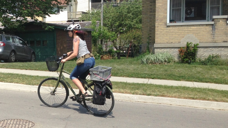 Shantell Powell cycles down Guelph Street in Kitchener on Wednesday, May 27, 2015. (David Imrie / CTV Kitchener)