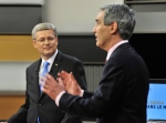 Prime Minister Stephen Harper looks on as Liberal Leader Michael Ignatieff speaks during the French language federal election debate in Ottawa on Wednesday, April 13, 2011. (Sean Kilpatrick / THE CANADIAN PRESS)