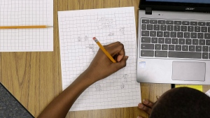 A 12-year-old student works on math problems in Annapolis, Md., in this Feb. 12, 2015 file photo. (AP / Patrick Semansky)