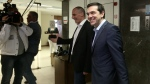 Greece's Prime Minister Alexis Tsipras, right, is welcomed by Finance Minister, Yanis Varoufakis, during his visit at the Finance Ministry in Athens Wednesday, May 27, 2015. Greece is out of cash to repay debts due as soon as next week. (AP / InTime News, Costas Baltas)