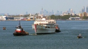 Tugs move Captain John's from Toronto harbour