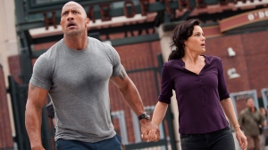 Dwayne Johnson, left, as Ray, and Carla Gugino as Emma, in a scene from Warner Bros. Pictures' action thriller, 'San Andreas.' (Warner Bros. Pictures)
