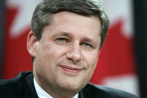 Then-Prime Minister designate Stephen Harper pauses for a moment during a news conference on Wednesday Feb. 1, 2006. (The Canadian Press/Jonathan Hayward)