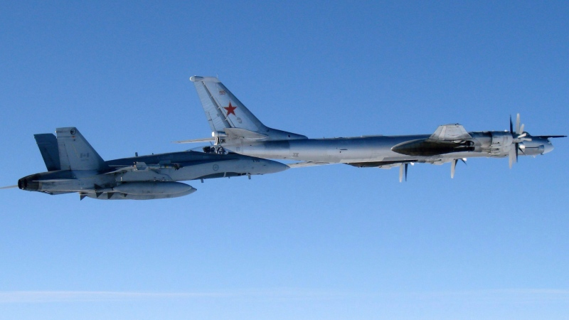 This undated file photo provided by the U.S. Air Force shows a Canadian Air Force F-18 Hornet jet escorting a Russian TU-95 Bear heavy bomber out of Canadian airspace.  (U.S. Air Force photo/Master Sgt. Cecilio M. Ricardo J)