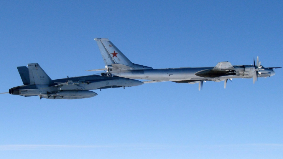 Canadian Air Force jet escorting a Russian bomber