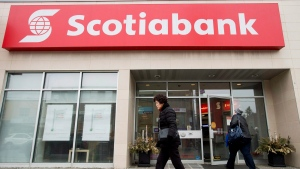 People are seen entering and leaving Scotiabank in Toronto on Apr. 9, 2015. (Nathan Denette / THE CANADIAN PRESS)
