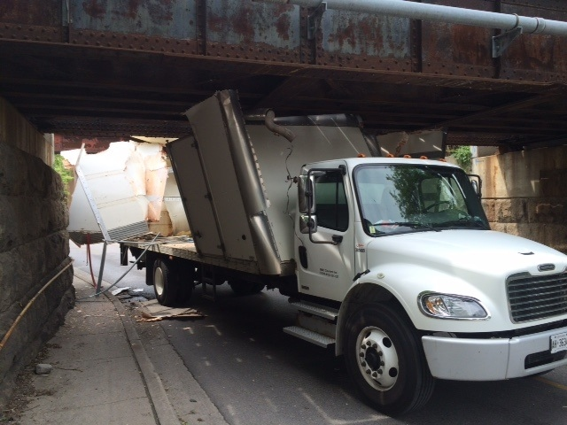 A truck is wedged under the Talbot Street bridge in London, Ont, on Friday, May 29, 2015. (Reta Ismail / CTV London)
