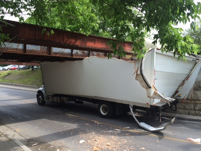 Truck wedged under bridge