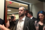 "Television actor Dustin Diamond, center, exits the courtroom in Port Washington, Wis., Friday night, May 29, 2015, after a 12-person jury convicted him of two misdemeanors stemming from a barroom fight, but a Wisconsin jury cleared the former ""Saved by the Bell"" actor of the most serious felony charge. (AP/Dana Ferguson"
