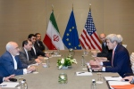 U.S. Secretary of State John Kerry, right, speaks with Iranian Foreign Minister Mohammad Javad Zarif, left, prior to a bilateral meeting for a new round of nuclear talks with Iran at the Intercontinental Hotel, in Geneva, Switzerland, Saturday, May 30, 2015. (Laurent Gillieron/Keystone)