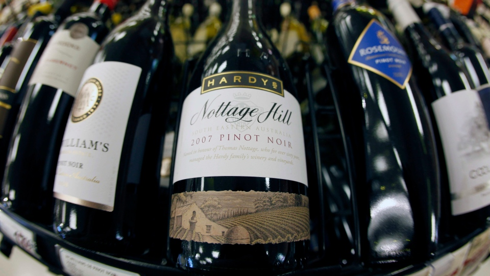 A bottle of Hardys Nottage Hill wine, centre, produced by Constellation Brands, Inc., is shown at Premier Wine & Spirits in Williamsville, N.Y., on Dec. 23, 2010. (David Duprey / AP Photo)