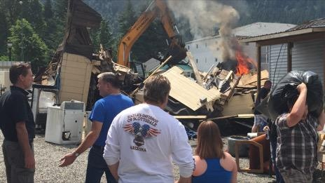 The fire sparked up again Sunday morning as people tried to save their belongings. (CTV)