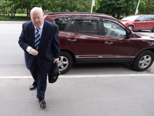 Suspended Sen. Mike Duffy heads to court in Ottawa on Monday, June 1, 2015. (Sean Kilpatrick / THE CANADIAN PRESS)