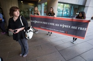 Janet Merlo, left, is joined by supporters as she stands outside B.C. Supreme Court before a hearing to seek certification of a class action lawsuit against the RCMP over sexual harassment and gender discrimination in Vancouver on Monday June 1, 2015. (Darryl Dyck / THE CANADIAN PRESS)