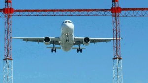 In this file photo, an airliner lands at Pearson International Airport in Toronto. (Adrian Wyld / THE CANADIAN PRESS)