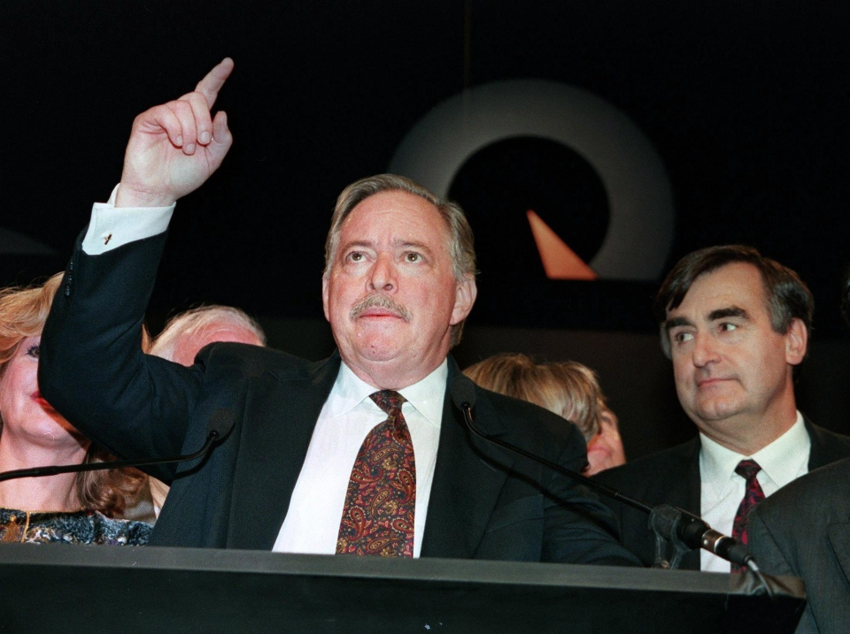 Parti Quebecois leader Jacques Parizeau delivers his victory speech while Bloc Quebecois Leader Lucien Bouchard looks on after Parizeau won the provincial election in Quebec on Sept.12, 1994. (Jacques Boissinot / THE CANADIAN PRESS)