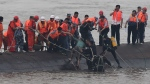 In this photo released by China's Xinhua News Agency, rescuers save a survivor, center, from the overturned passenger ship in the Jianli section of the Yangtze River in central China's Hubei Province Tuesday, June 2, 2015. (Cheng Min/Xinhua via AP)