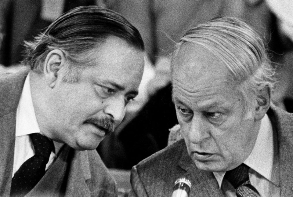 Then-Quebec Premier Rene Levesque talks with his then-Finance Minister Jacques Parizeau after Levesque arrived late for the first session of the premier's conference on the economy in Ottawa, February 2, 1982. (Ron Poling / THE CANADIAN PRESS)