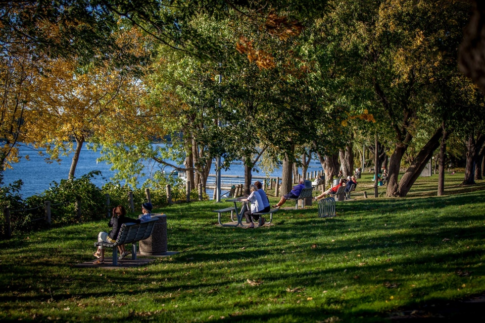 People sit by the Saint Lawrence River in Boucherville, Quebec in this file photo. (City of Boucherville / Facebook)