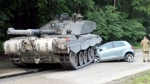 A British tank driving on a road in Germany crushed the front of a car on Tuesday, June 2, 2015.