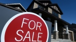 A sign advertises a new home for sale in Carleton Place, Ont. on Tuesday, March 17, 2015. (Sean Kilpatrick  / THE CANADIAN PRESS)