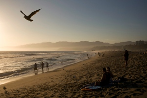 People walk along the beach Friday, Aug. 29, 2014, in Santa Monica, Calif. (Jae C. Hong / AP Photo)