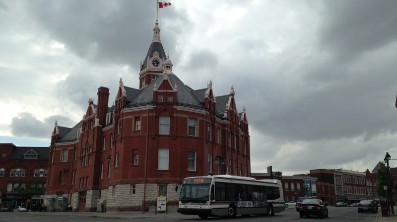 A bus rolls past Stratford City Hall on a gloomy day. (Abigail Bimman / CTV Kitchener)
