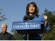 Republican vice presidential candidate, Alaska Gov. Sarah Palin, right, speaks as Florida Gov. Charlie Crist watches during a campaign rally in New Port Richey, Fla., Saturday, Nov. 1, 2008. (AP Photo / Mike Carlson)