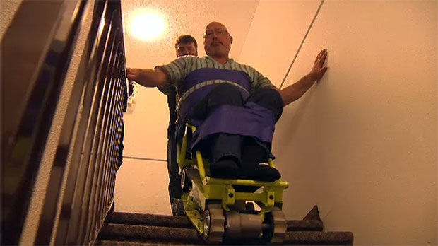Richard McBride tries out a lift from Canwest Elevator on the stairs inside his condo building.