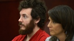 In this March 12, 2013, file photo, James Holmes, left, and defense attorney Tamara Brady appear in district court in Centennial, Colo., for his arraignment. Prosecutors are methodically building a case that Holmes knew right from wrong when he planned and carried out the deadly Colorado theater shooting, hoping to convince jurors that he should be convicted and executed and not sent to a mental hospital. (RJ Sangosti/The Denver Post via AP, Pool, File)