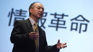 """Softbank founder and chief executive Masayoshi Son speaks in front of a Japanese word that reads """"information revolution"""" during a news conference in Tokyo, Tuesday, Nov. 4, 2014. (AP Photo/Eugene Hoshiko)"""
