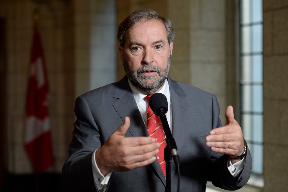 NDP Leader Tom Mulcair talks to media after a party caucus meeting in Ottawa on Wednesday, June 3, 2015. (Adrian Wyld / The Canadian Press)