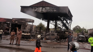 Ghana security personnel stand near the gas station that exploded in Accra, Ghana, Thursday, June 4, 2015. (AP / Christian Thompson)