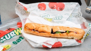This Aug. 11, 2009, file photo, shows a chicken breast sandwich and water from subway on a kitchen counter in New York. (AP /Seth Wenig)