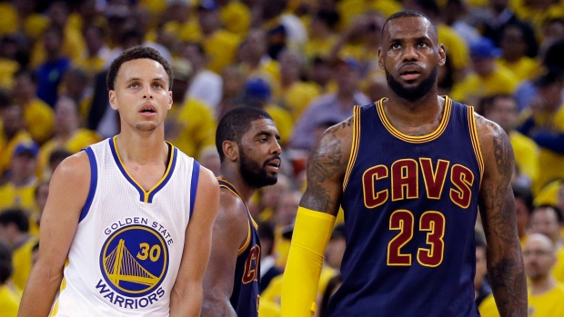 341f6fe19f77 Golden State Warriors guard Stephen Curry (30) and Cleveland Cavaliers  forward LeBron James (23) walk on the floor during the second half of Game  1 of ...