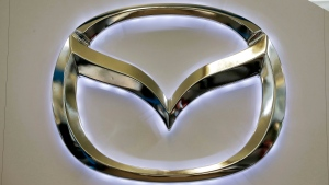 Mazda logo on a sign at the 2013 Pittsburgh Auto Show. (Gene J. Puskar / AP)