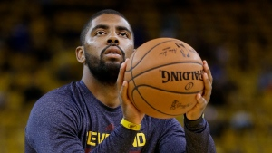 Cleveland Cavaliers guard Kyrie Irving warms up before Game 1 of basketball's NBA Finals against the Golden State Warriors in Oakland, Calif., Thursday, June 4, 2015. (AP Photo/Ben Margot)