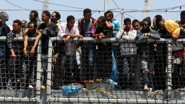 Migrants wait on ship in Italy