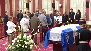 Mourners line up to view former Quebec Premier Jacques Parizeau lying in state at the Quebec legislature.