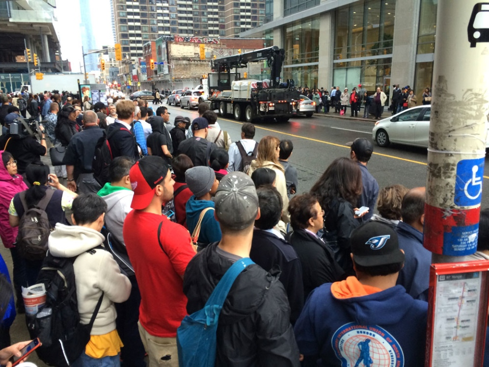Commuters gather at Yonge and Bloor after all subway service was halted in Toronto, Monday. June 8, 2015. (George Stamou / CTV News Toronto)