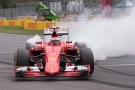 Ferrari driver Kimi Raikkonen of Finland spins his tires after sliding his car at the hairpin during the Canadian Grand Prix in Montreal on Sunday, June 7, 2015. THE CANADIAN PRESS/Jacques Boissinot