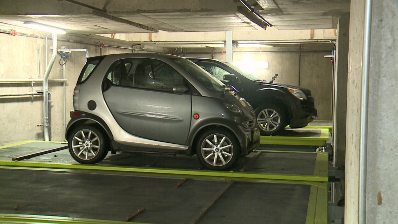 Moving platforms are used to park cars in Ottawa's first puzzle parking garage, June 8, 2015