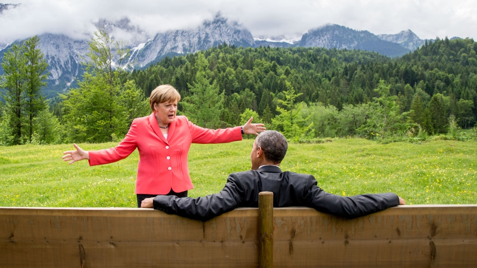 German Chancellor Angela Merkel speaks with U.S. President Barack Obama at Schloss Elmau hotel near Garmisch-Partenkirchen, southern Germany during the G-7 summit on Monday, June 8, 2015. (AP / Michaek Kappeler)