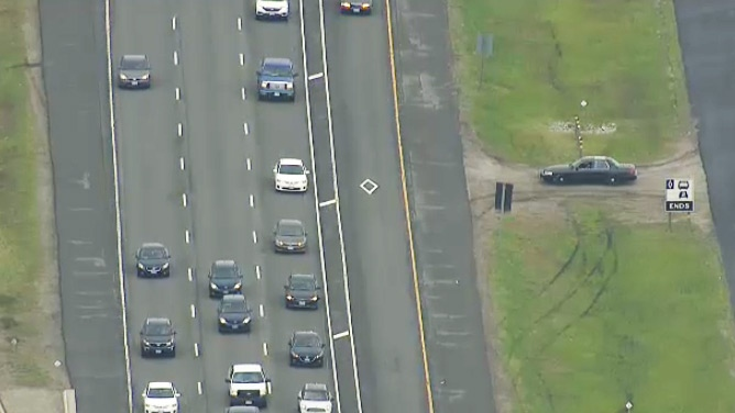 A police car patrols an HOV lane as seen from the CTV News chopper on Tuesday, June 9, 2015.